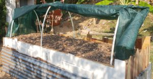 how to upcycle a raised garden bed - hoop enclosure open