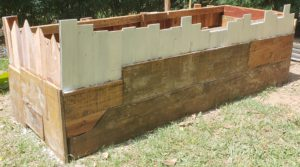 how to upcycle a raised garden bed - paint and varnish