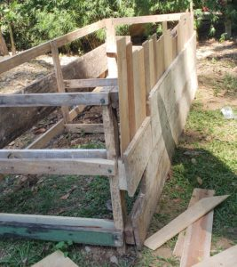 how to upcycle a raised garden bed - secure frame in place